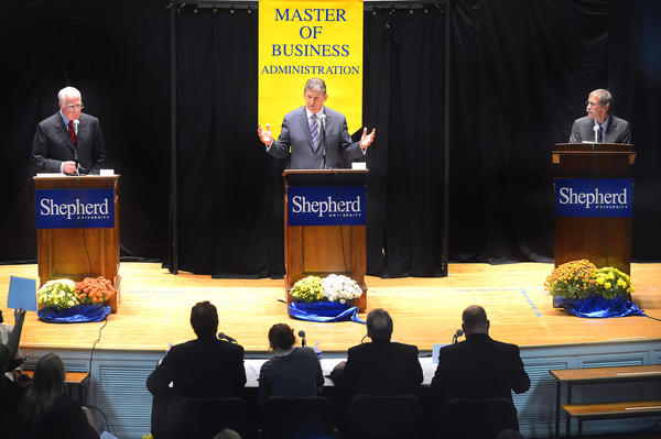 Senator Joe Manchin D-W.Va., center, faced challengers for his seat Republican John Raese, left, and Mountain Party candidate Bob Henry Baber in a debate Tuesday night at Shepherd University's Reynolds Hall in Shepherdstown, W.Va.