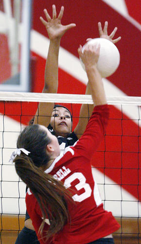 Pasadena's Bayley Neubauer stretches to block Burroughs' Caitlin Cottrell in a Pacific League girls volleyball match at Pasadena High School on Tuesday, October 2, 2012.