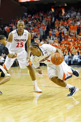 February 8, 2012; Charlottesville, VA USA; Virginia Cavaliers guard Jontel Evans (1) dribbles the ball as Wake Forest Demon Deacons guard Tony Chennault (1) defends in the second half at John Paul Jones Arena. The Cavaliers won 68-44. Mandatory Credit: Geoff Burke-US PRESSWIRE