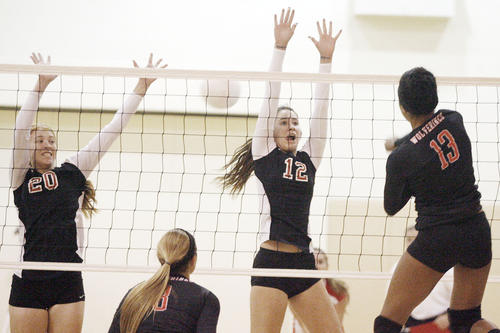 FSHA's Ally Clapp, from left, and Ali McCollum try to block a spike from Harvard-Westlake's Arielle Winfield during a match at FSHA in La Canada l on Tuesday, October 2, 2012.
