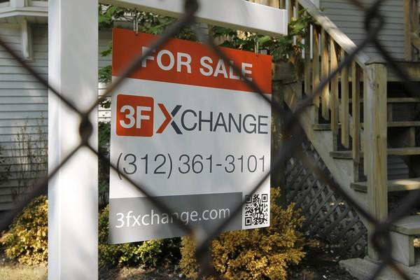 A house with a for-sale sign sits in the 4300 block of North Albany Avenue, which has also had foreclosures.