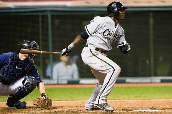 Orlando Hudson hits an RBI single during the sixth inning against the Indians.