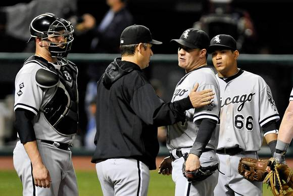 White Sox manager Robin Ventura puts his hand on the shoulder of starter Jake Peavy during a pitching change in the ninth inning against the Indians. Also on the mound are catcher Tyler Flowers, left, and shortstop Ray Olmedo.