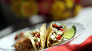 "Carnitas, which means ""little meats"" in Spanish, are seasoned, fried pork-filled tacos. They are typically served with soft corn tortillas topped with salsa."