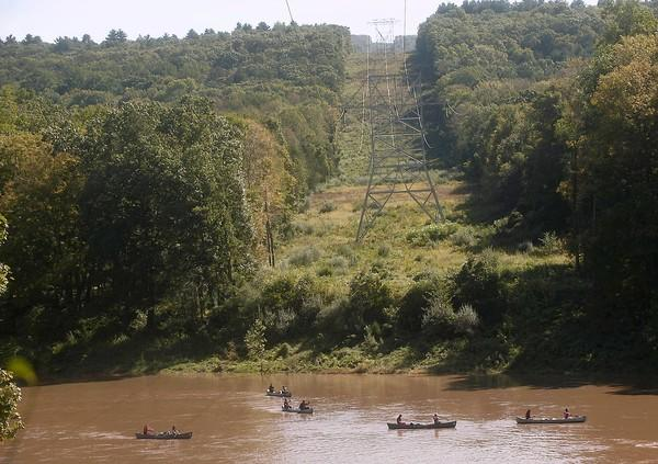 Canoes head south along the Delaware River - near utility lines crossing into Pennsylvania from New Jersey along the Freeman Tract in the Delaware Water Gap National Recreation Area in Monroe County last week.