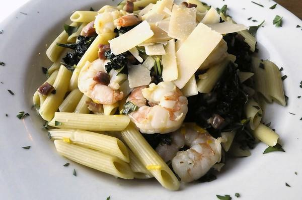 Seafood is king on the Dock & Dine menu including this Shrimp Pasta, with pancetta, kale, chardonnay, and penne dish.