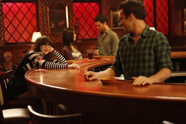 "During a flashback, Jess (Zooey Deschanel, L) contemplates her relationship with Nick (Jake Johnson, R) on ""New Girl."""