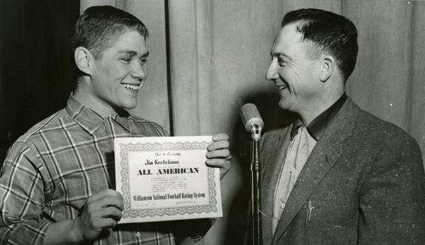 Jim Kretchman of Faulkton gets his all-american award in 1954 from coach Clark Swisher.