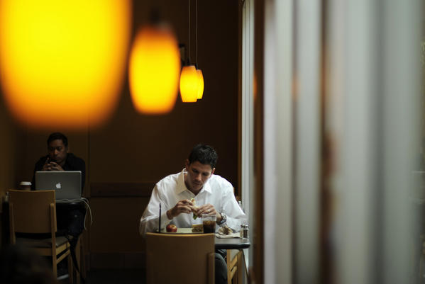 A customer at a Panera Bread during lunch hour. Young white men are the typical quick-service restaurant patron.