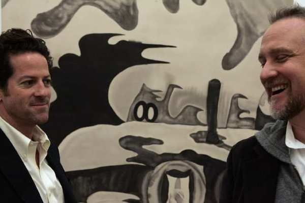 Timothy Blum, left, and Jeff Poe, co-owners of Blum & Poe, stand in front of an untitled piece by artist Chris Vasell in 2007.