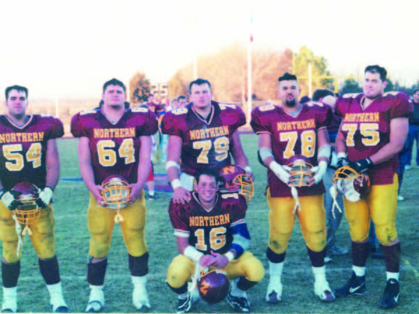Northern's offensive line of (from left) David Mohn, Eric Cuka, Lee Keller, Bob Hall and Vaughn Ayala formed a dominant front five in 1999. Here they pose with quarterback Nate Breske following a game at the old Swisher Field.