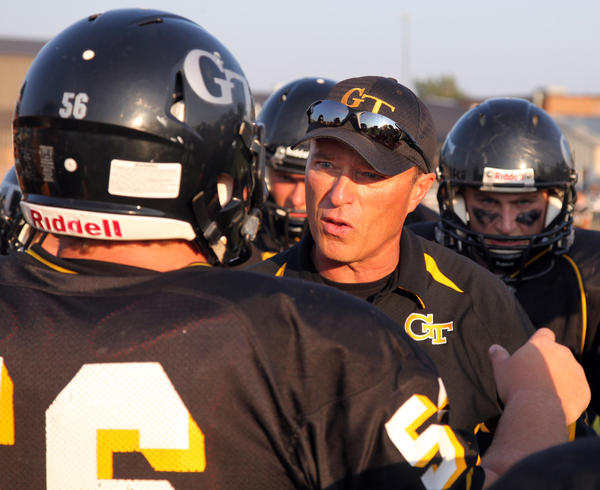 Groton head football coach Shaun Wanner talks with Dalton Locke (56) during a pregame at Doney Field in Groton.