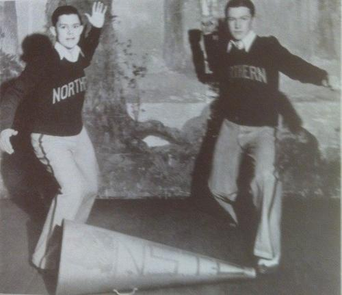 "Burton C. Tiffany, left, and Martin S. Swensen were the yellmasters for the 1934 Northern State football team, leading the student body in one of the mort popular cheers of the time"" ""Sssss-s-s-s-s-s-s-BOOM! - ah!; NORTHERN WOLVES - Rah! Rah! Rah!"