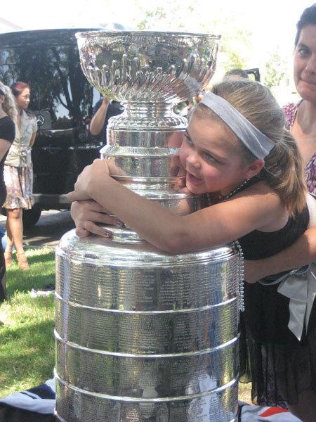 Genny Shepler hugs the Stanley Cup.