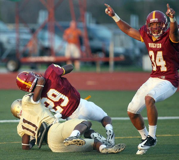 Northern State University's Logan Dosch, right, celebrates as teammate Marquis Mulkey (29) intercepted a pass intended for Southwest Minnesota State's Anthony Dean (11) during Thursday night's game at Swisher Field. Mulkey's interception in the end zone resulted in a touchback for NSU and the ball at the 20 yard line.