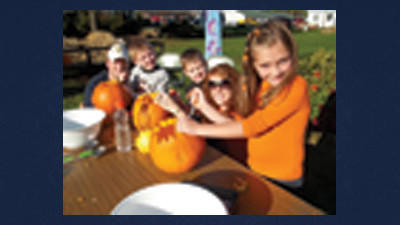 The Wagner family of Rockwood enjoy festivities at the Arts Center during PumpkinFest.