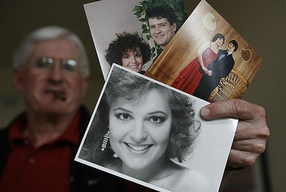 Jim Palin, father-in-law of Alaska Gov. Sarah Palin, shows family photos of the newly s