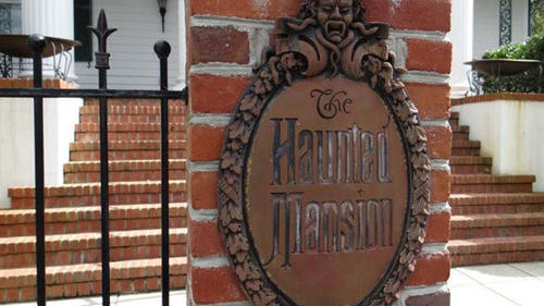 Foolish mortals are greeted at the front gate of the Haunted Mansion replica home by a welcome plaque identical to that of the Disneyland attraction.