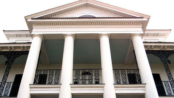 The replica Haunted Mansion outside Atlanta features the same four white pillars found at the original Disneyland attraction.