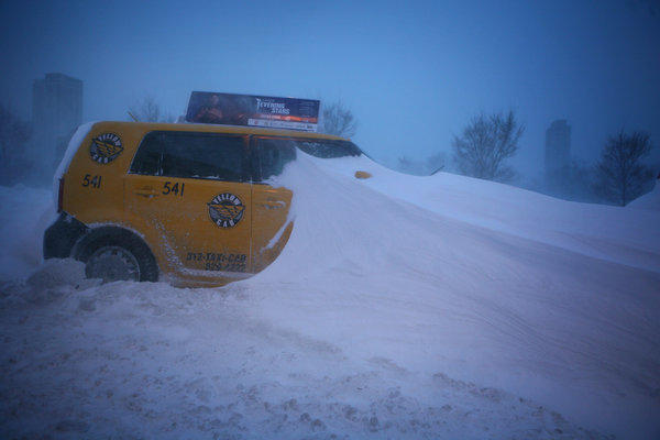 An taxi sits abandoned on northbound Lake Shore Drive after an epic blizzard hit Chicago in February 2011.