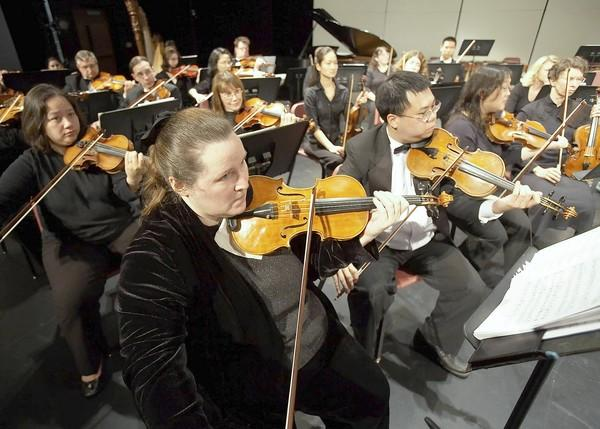 The Columbia Orchestra violins, led by Concertmaster Brenda Anna.