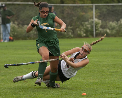 Emmaus Teresa Carotenuto (left) collides with Emmaus Emily Nonnemacher during girl's field hockey at Northampton High School on Wednesday.