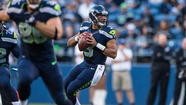 "Mute the external blare of negativity being generated by <a title=""Russell Wilson"" href=""http://www.seahawks.com/team/roster/russell-wilson/61b432f5-cd6c-4c4f-a8a4-9e307ffa4f3a/"">Russell Wilson</a>'s first four starts as the Seahawks' quarterback long enough to consider this: Just a quarter of the way into his rookie season, Wilson already has emerged victorious in head-to-head matchups against the Green Bay Packers' Aaron Rodgers and the Dallas Cowboys' Tony Romo."