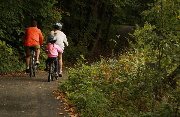A family bicycles in the bike path at Fullersburg Woods Forest Preserve in Oak Brook on Sept. 21, 2012.