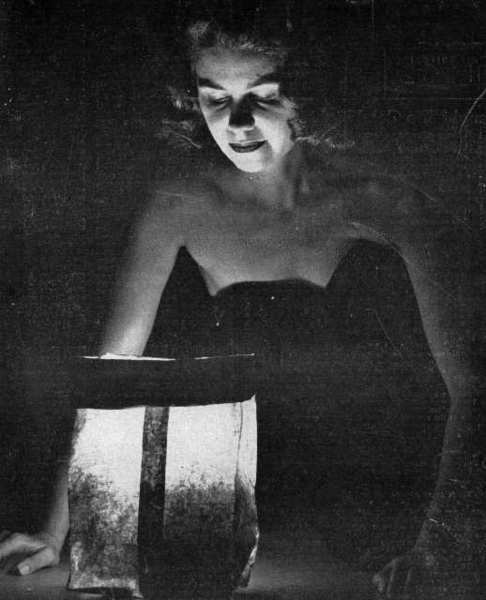 Mrs. George Turner of Baptiste Way poses in October 1952 with a paper lantern, one of many that would be used to light the playing field on Cornishon Avenue for the first Harvest Moon Dance. The fundraiser was held to raise funds for a paved driveway to the new Youth House.