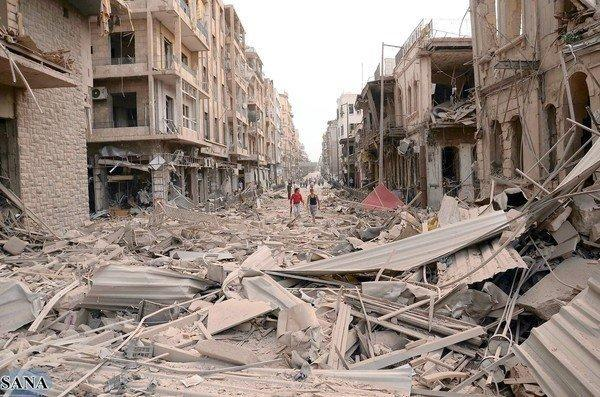 Piles of rubble cover an Aleppo street after a series of suicide bombings in the Syrian city left dozens dead.