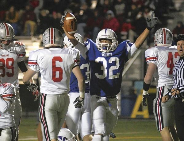 Nazareth's Jordan Gray (32) scores Nazareth's first touchdown against Parkland at Nazareth on Friday, November 18, 2011.