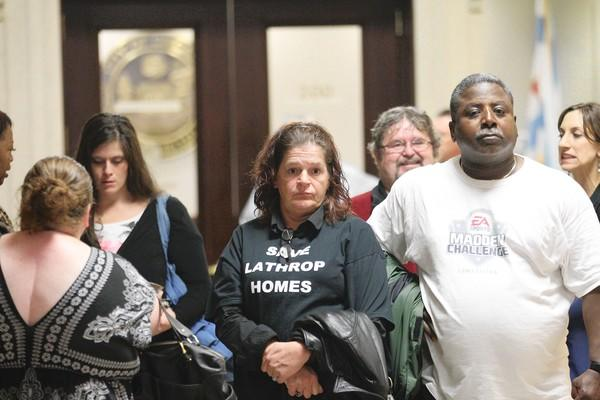 Debra Cady Medlock, center, was among the protesters at City Hall on Wednesday, urging Chicago Housing Authority officials to speed up efforts to relocate housing development residents.