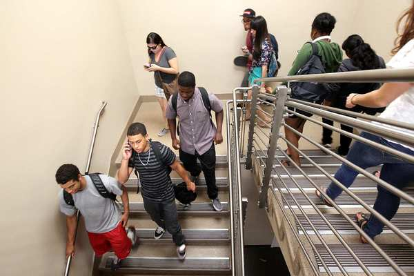 "Jeffrey MacGillivray, 20, second from bottom left, heads out after his philosophy class at El Camino Community College in Torrance. ""I was thinking I can just go to community college, do my two years and transfer,"" MacGillivray said. ""I had no idea I'd probably end up at El Camino for four years."""