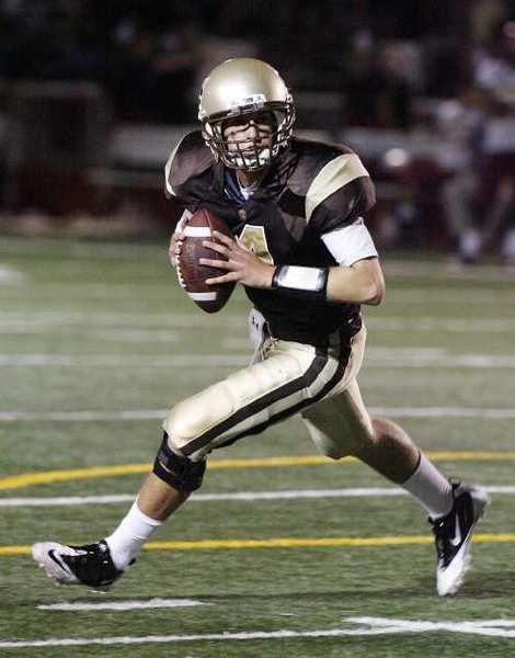 ARCHIVE PHOTO: St. Francis quarterback Jared Lebowitz rolls out to find a receiver against Arcadia.