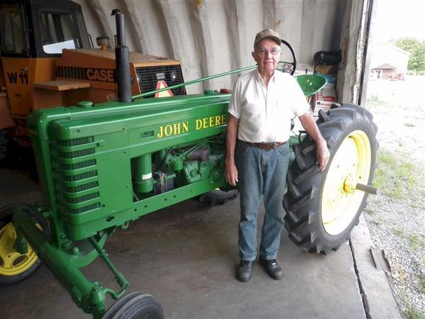 Guy Walker stands beside his 1941 John Deere H. This tractor is believed to be one of only 125 of this particular model built with a wide front axle. Walker restored this tractor in 1996 and notes that he has only ever seen two other tractors with the same wide front end at shows in New York and Florida.