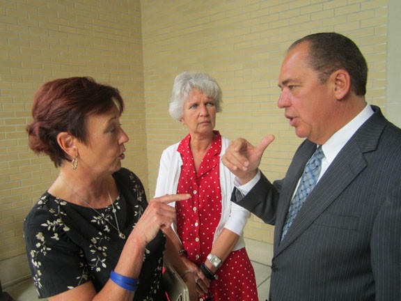 Berkeley Springs Mayor Susan Webster, left, asks West Virginia Gov. Earl Ray Tomblin for $7,100 so the city can repair damage to Liberty Road and Ridge Road from a flood that ravaged the community last month. Berkeley Springs Town Clerk Deb Peck looks on.