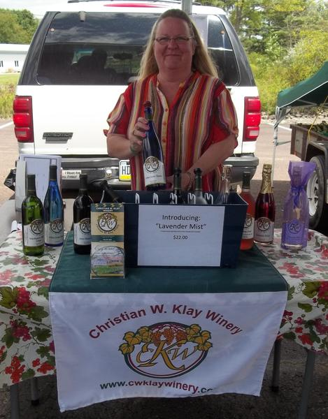 Christian W. Klay Winery's Patty Heine welcomes shoppers to the Somerset County Farmers' Market each Saturday, offering a sampling of the Winery's finest.