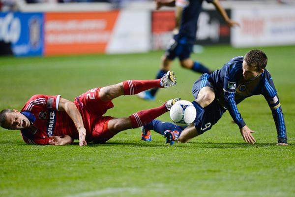 Fire defender Austin Berry and Union forward Jack McInerney collide into each other during the second half at Toyota Park.