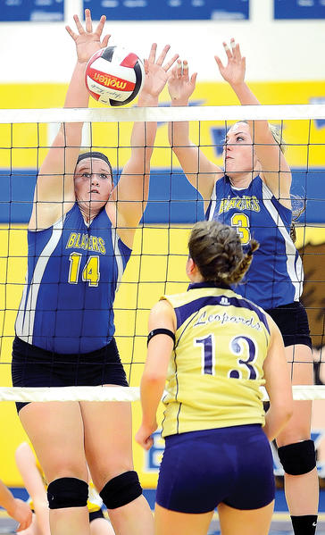 Clear Spring's Kristen Mellott (14) and Sarah Elwood (3) team to block a shot by Smithsburg's Amanda Snowden (13) on Wednesday during the Leopards' 3-1 victory.