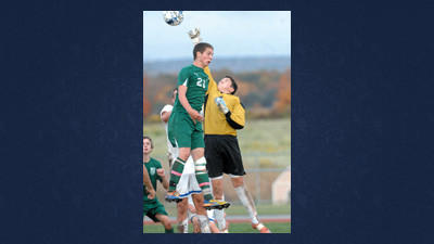 North Star's Scott Kuncher and Berlin keeper Marshal Engleka fight over a Cougar corner kick in the second period of soccer action on Wednesday.