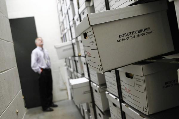 Pat Kelly, file storage manager for the Cook County Circuit Court clerk's office, enters a room in the Daley Center known as the vault, where sealed court documents are stored.