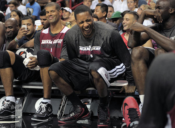Miami Heat guard Mario Chalmers laughs on the bench during the Heat's Red and White game.
