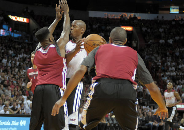 Miami Heat guard Ray Allen runs into Norris Cole during the Heat's Red and White game.