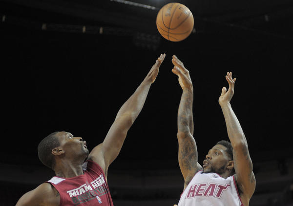 Miami Heat forward Udonis Haslem takes a shot over Chris Bosh during the Heat's Red and White game.