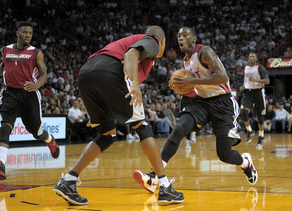 Miami Heat guard Terrel Harris makes a move on Shane Battier during the Heat's Red and White game