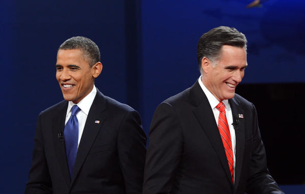 U.S. President Barack Obama and Republican candidate Mitt Romney finish the first presidential debate in Denver, Colo.