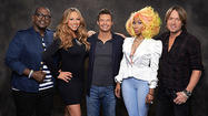 "<span style=""font-size: small;"">It's the battle of diva judges on American Idol…and we're not talking about Keith Urban. The new season of Idol hasn't even hit the airwaves yet, but catfights between judges Nicki Minaj and Mariah Carey are already making headlines everywhere. TMZ obtained footage from Idol 's recent audition stop in Charlotte, North Carolina showing the back-and-forth screaming match between the rapper and pop singer. Country's own Keith Urban is positioned between the two, staying mum the whole time. Reportedly, head honchos ended Charlotte auditions early following the blow up. They're worried the two won't be able to co-exist for the long haul. American Idol returns to FOX January of 2013.  See the footage <a href=""http://www.tmz.com/2012/10/02/nicki-minaj-mariah-carey-fight-american-idol-audition/"">here</a>. </span>"