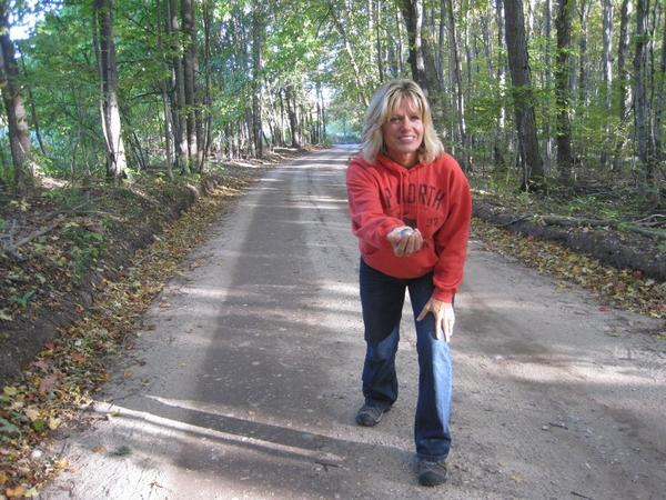 Kathy Patterson, of Boyne City, works on her road bowling skills in preparation for an Irish road bowling party that is planned for Sunday, Oct. 14, on Addis Road in Boyne City.