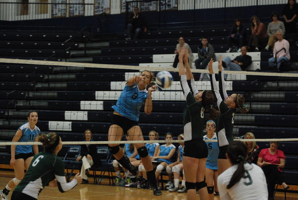 Petoskey senior middle hitter Megan Tompkins (left) had 21 kills as the Northmen defeated Traverse City Central Wednesday in a Big North Conference match.
