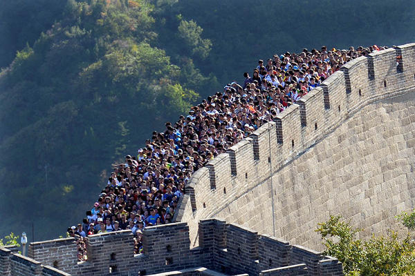 Visitors crowd the Great Wall of China as Golden Week -- the fall vacation period that starts with National Day on Oct. 1 and sees most businesses, schools and government offices shut down -- gets into full swing. Hundreds of millions of tourists have flocked to scenic spots, resorts and other tourism destinations across the country while millions more have arrived in Beijing to visit the capital.